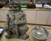 An Annamese style pottery figure of a deity and Persian 'fish' dish