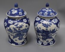 A pair of Chinese blue and white vases and covers height 28cm