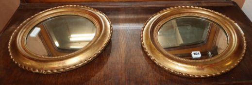 A pair of oval 19th century French giltwood wall mirrors H.45cm