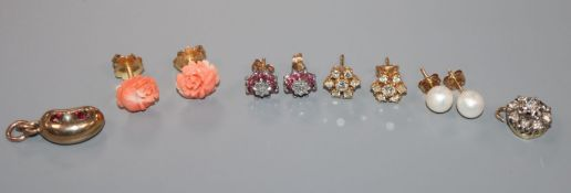 Two pairs of 18ct gold and gem set ear studs including diamond cluster, a 14k pair, a 9ct pair, a