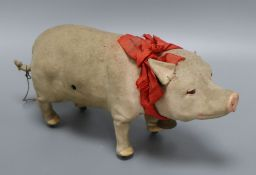 A clockwork squealing pig length 31cm