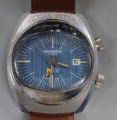 A 1970's? steel Memostar alarm manual wind wrist watch, on associated leather strap.