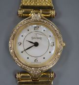 A ladys' 18ct gold wristwatch by Tanishq, India with diamond set bezel, on articulated bracelet (