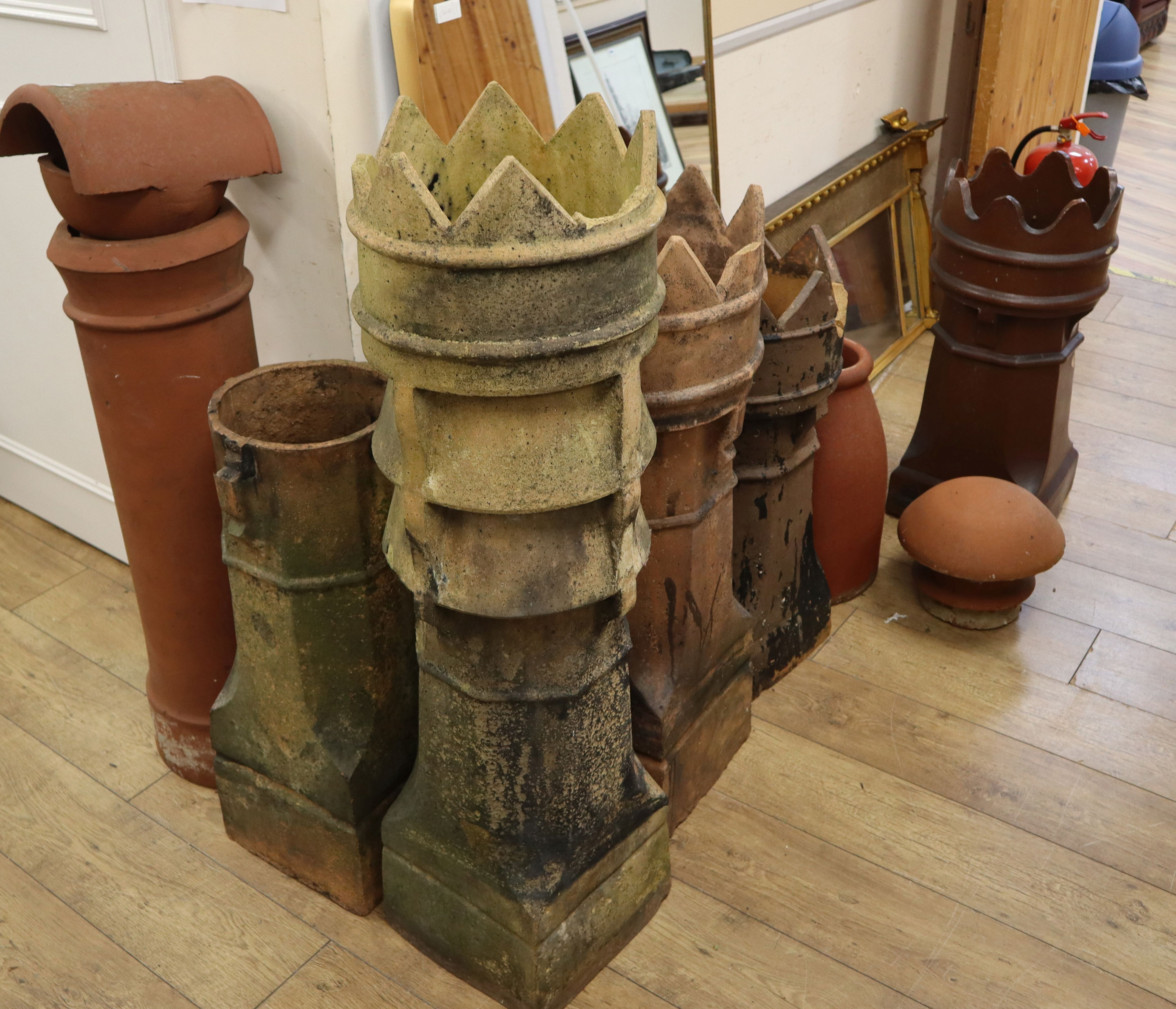 Lot 850 - Seven earthenware chimney pots and two cowls Tallest 114cm