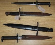 Two Swedish 1896 Mauser bayonets with steel scabbards (EJ AB) and two Spanish Mauser 1941