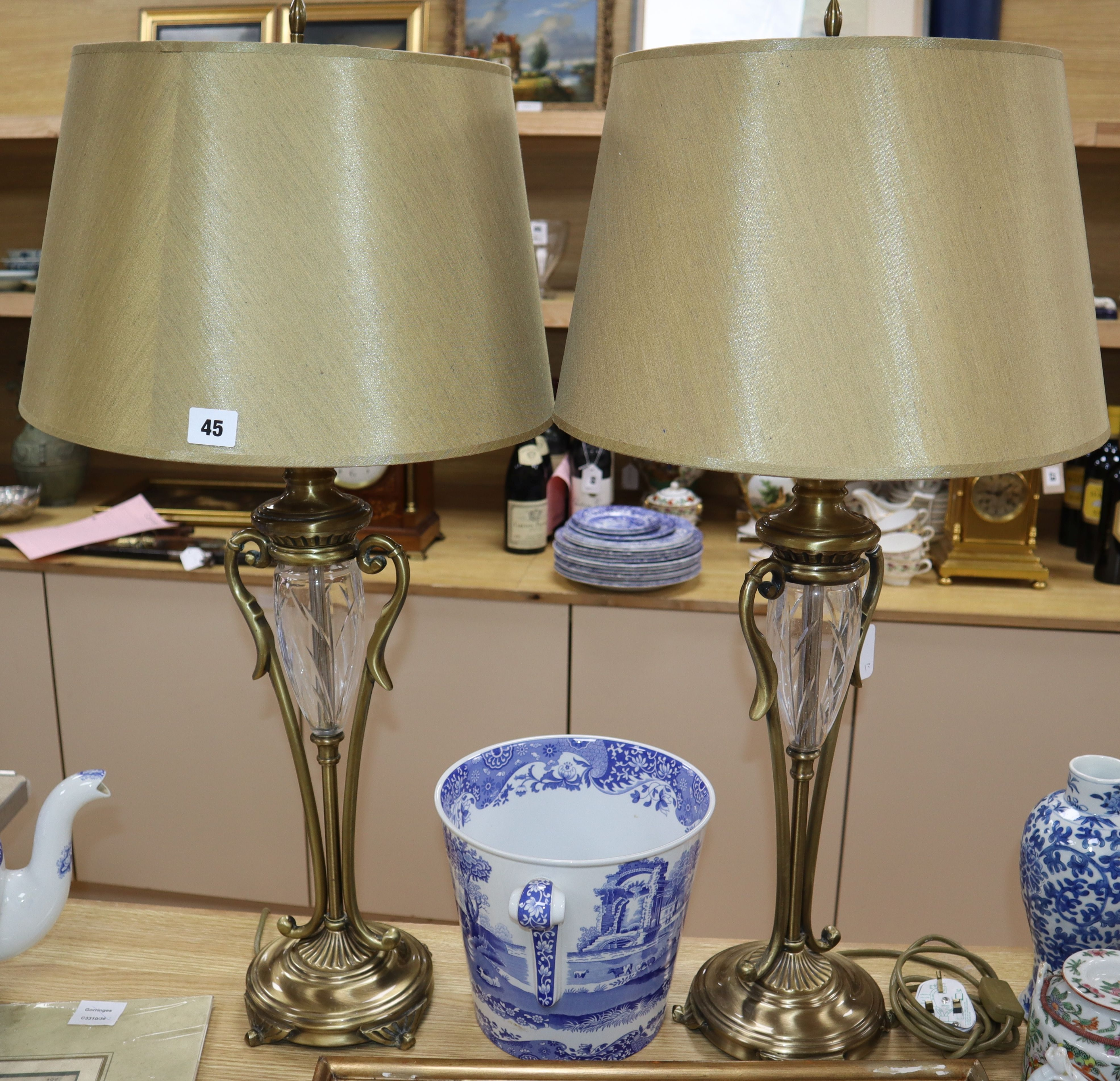 Lot 45 - A pair of cut glass and brass lamps with shades