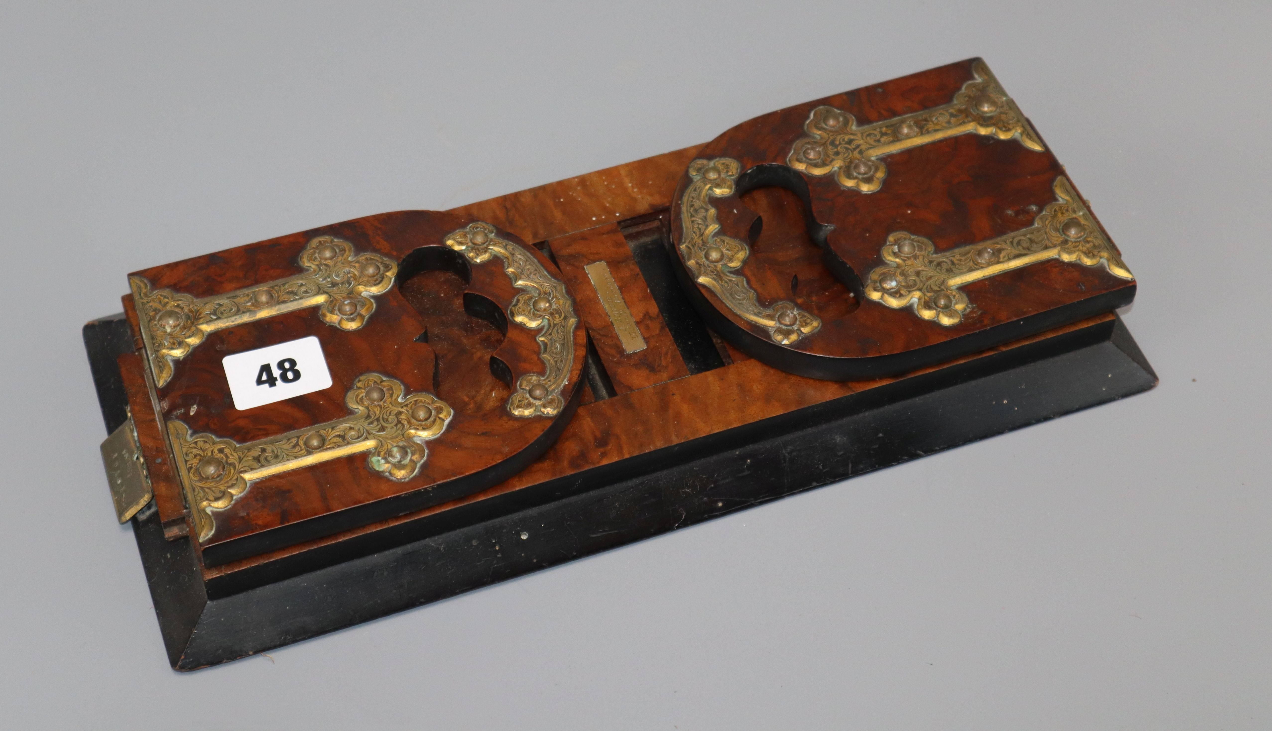 Lot 48 - A Victorian walnut and brass strapwork bookslide
