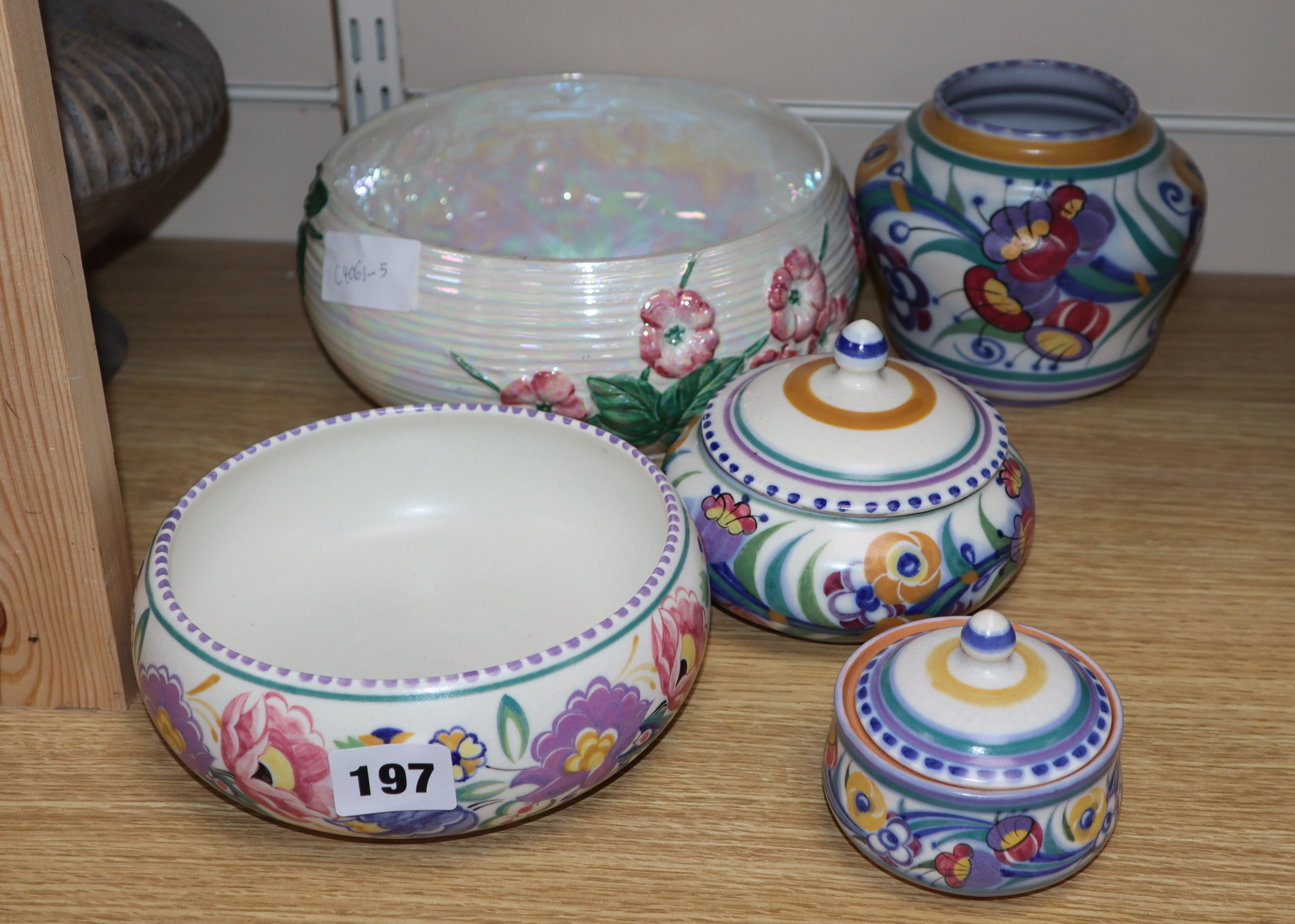 Lot 197 - A Poole pottery vase, bowl and two jars and cover and a Maling bowl