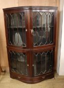 A 1920's mahogany bowfront display cabinet W.125cm