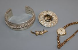 A Scottish silver and citrine brooch, a white metal bangle and a Tissot wrist watch and a 9ct gold