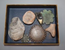 A bronze and stone Egyptian eye and other artefactsProvenance - from the family of a Victorian