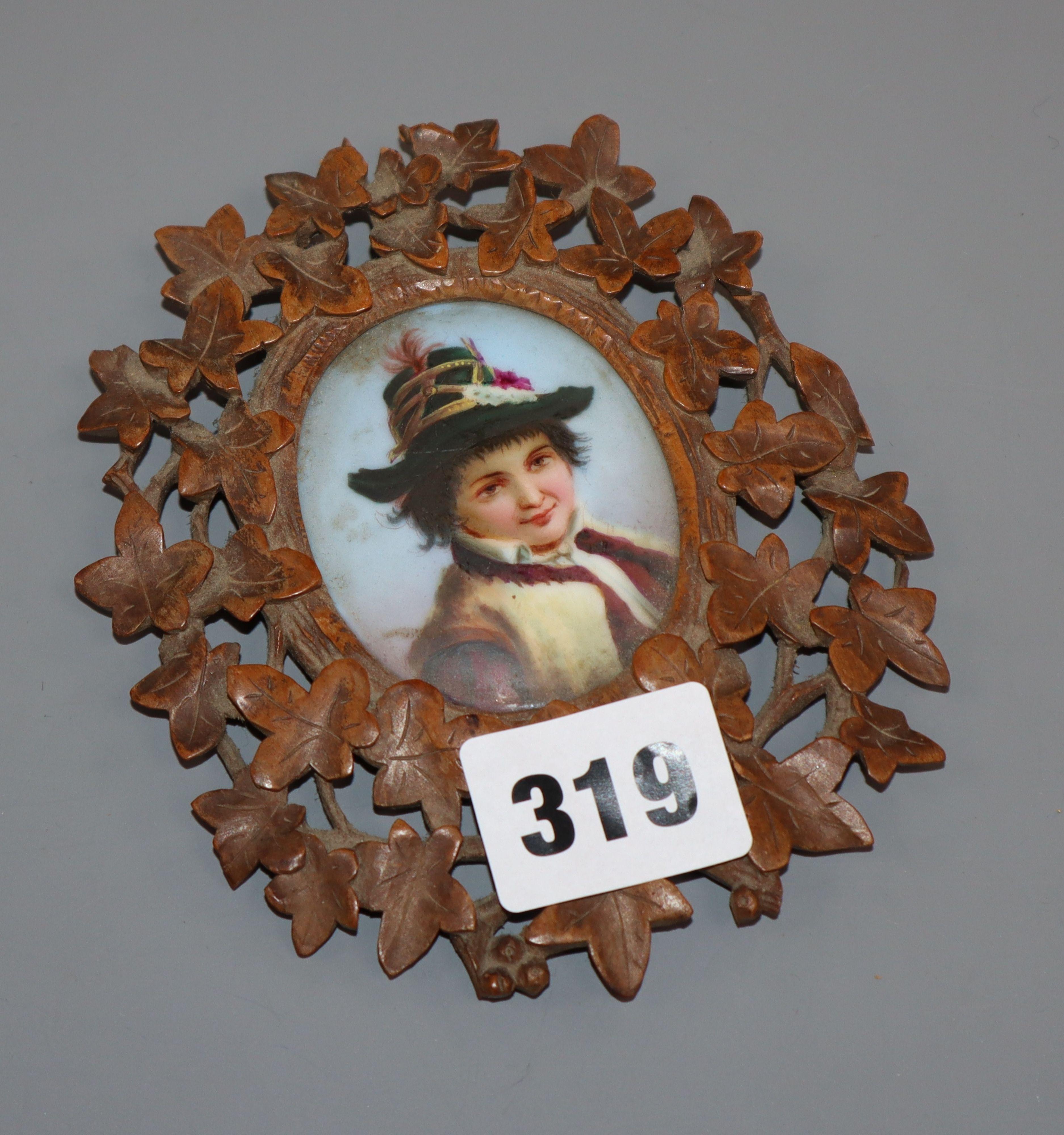 Lot 319 - A Black Forest framed porcelain portrait miniature
