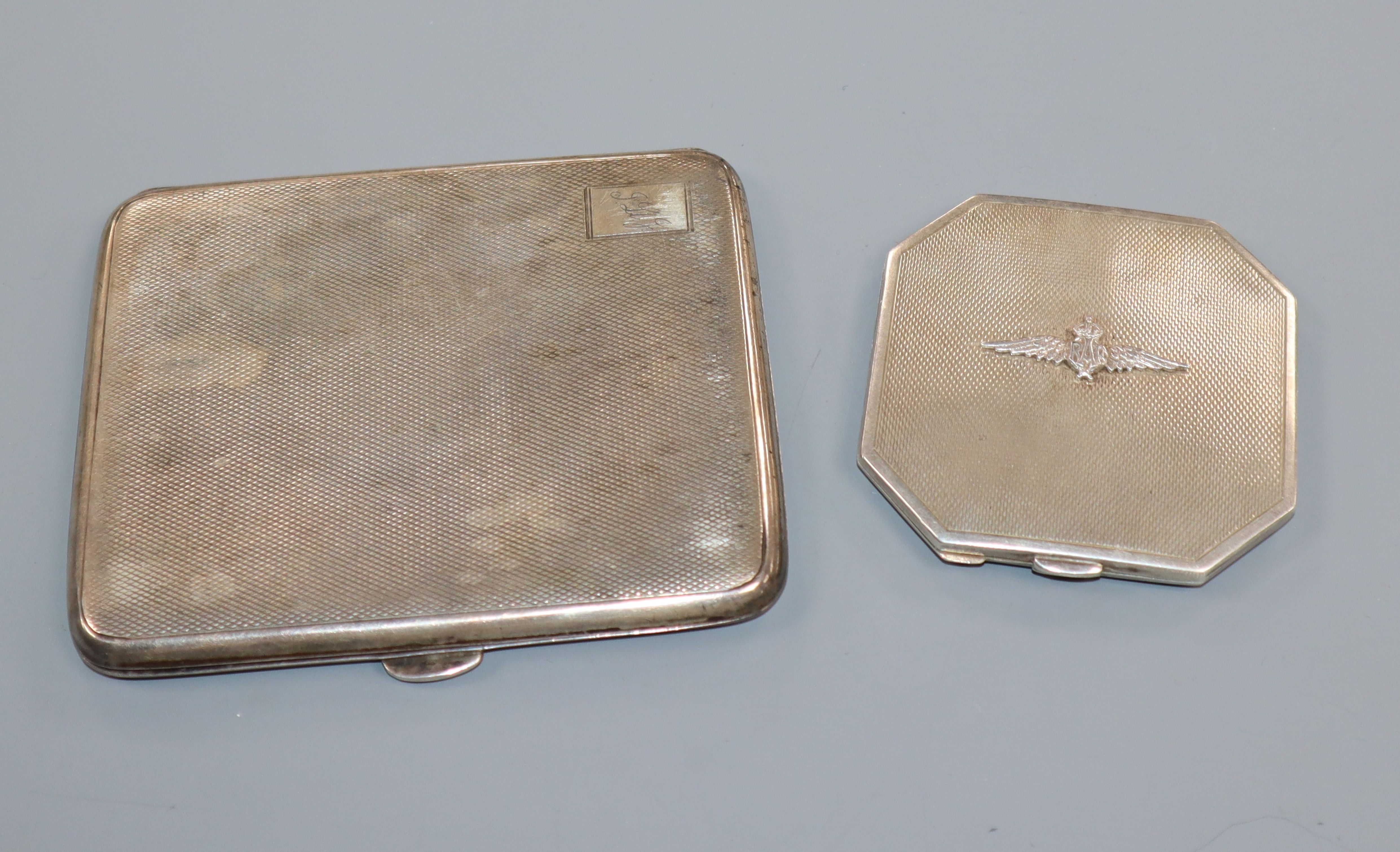 Lot 670 - A George V silver engine turned cigarette case and a silver 'RAF' compact.