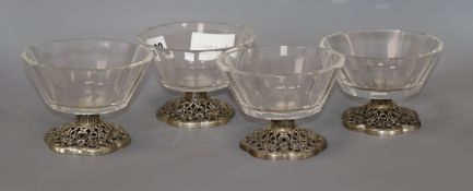 A set of four 835 white metal and glass dessert bowls, possibly by Villeroy & Boch
