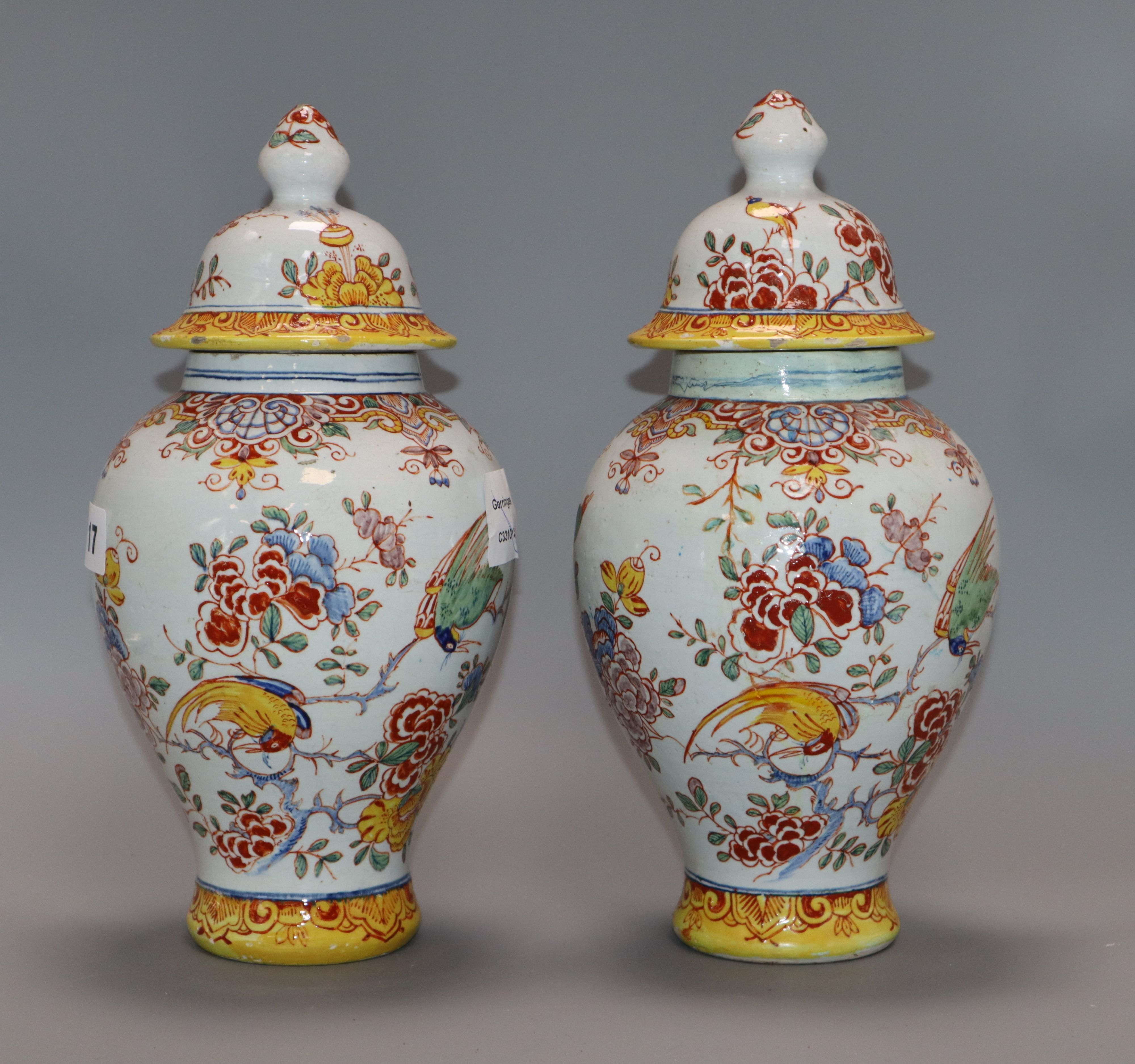 Lot 17 - A pair of 19th century French faience vases and covers height 29cm