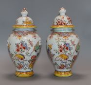 A pair of 19th century French faience vases and covers height 29cm