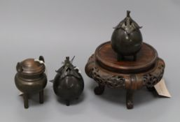 Three bronze koros and covers and a Chinese carved hardwood stand