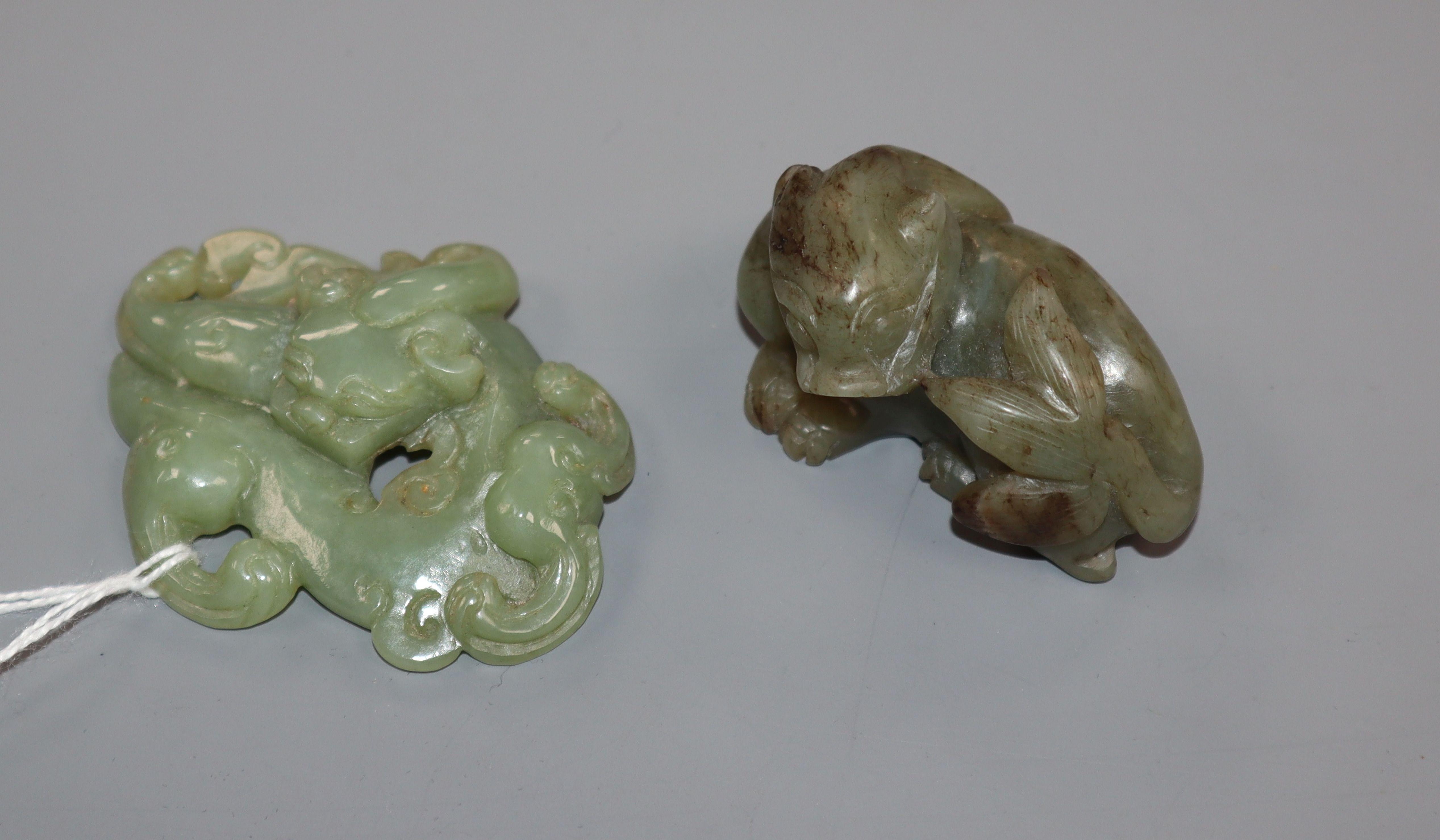 Lot 299 - A Chinese celadon jade bixi plaque and a similar jade figure