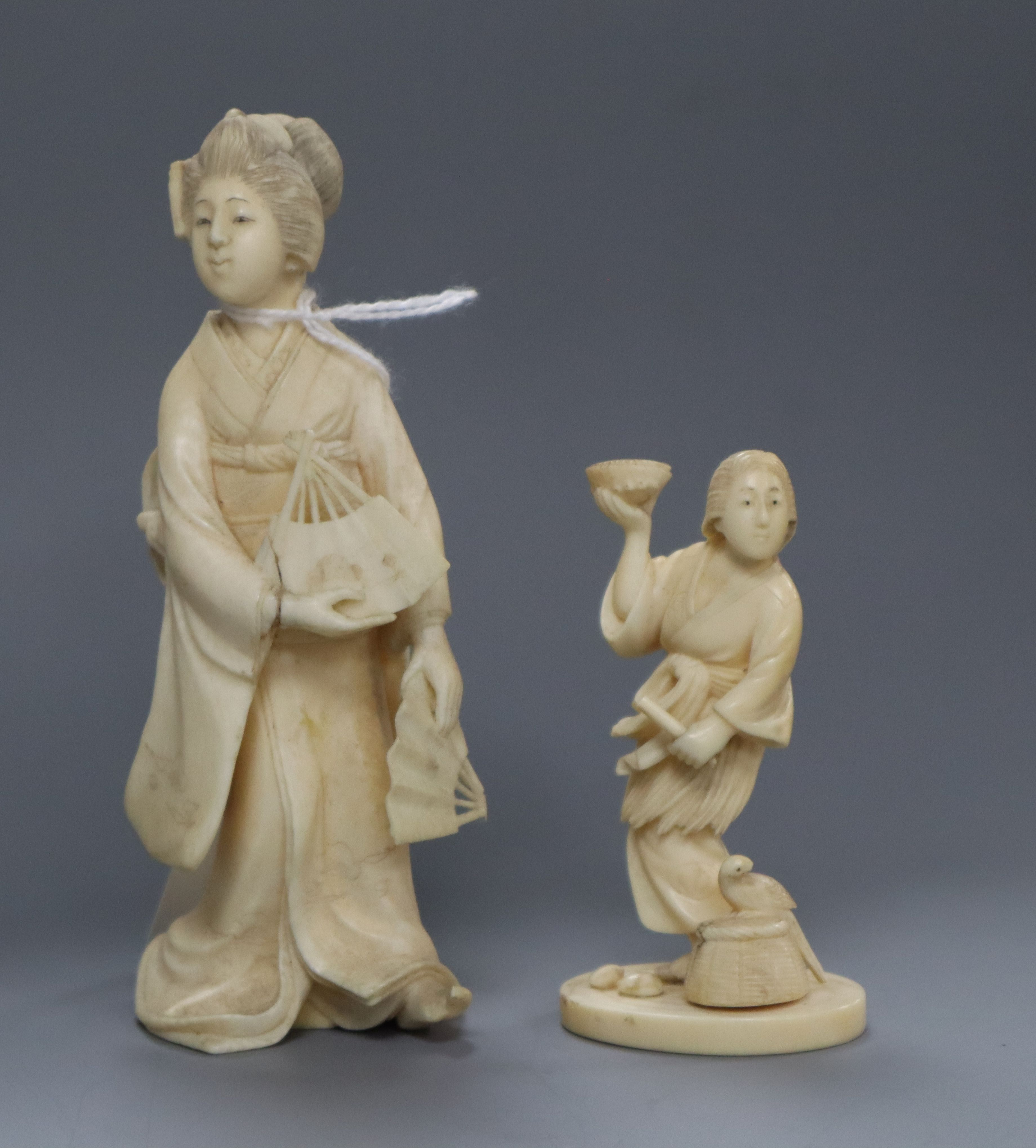 Lot 262 - Two Japanese ivory figures of a fisherman and a bijin Meiji period tallest 12cm