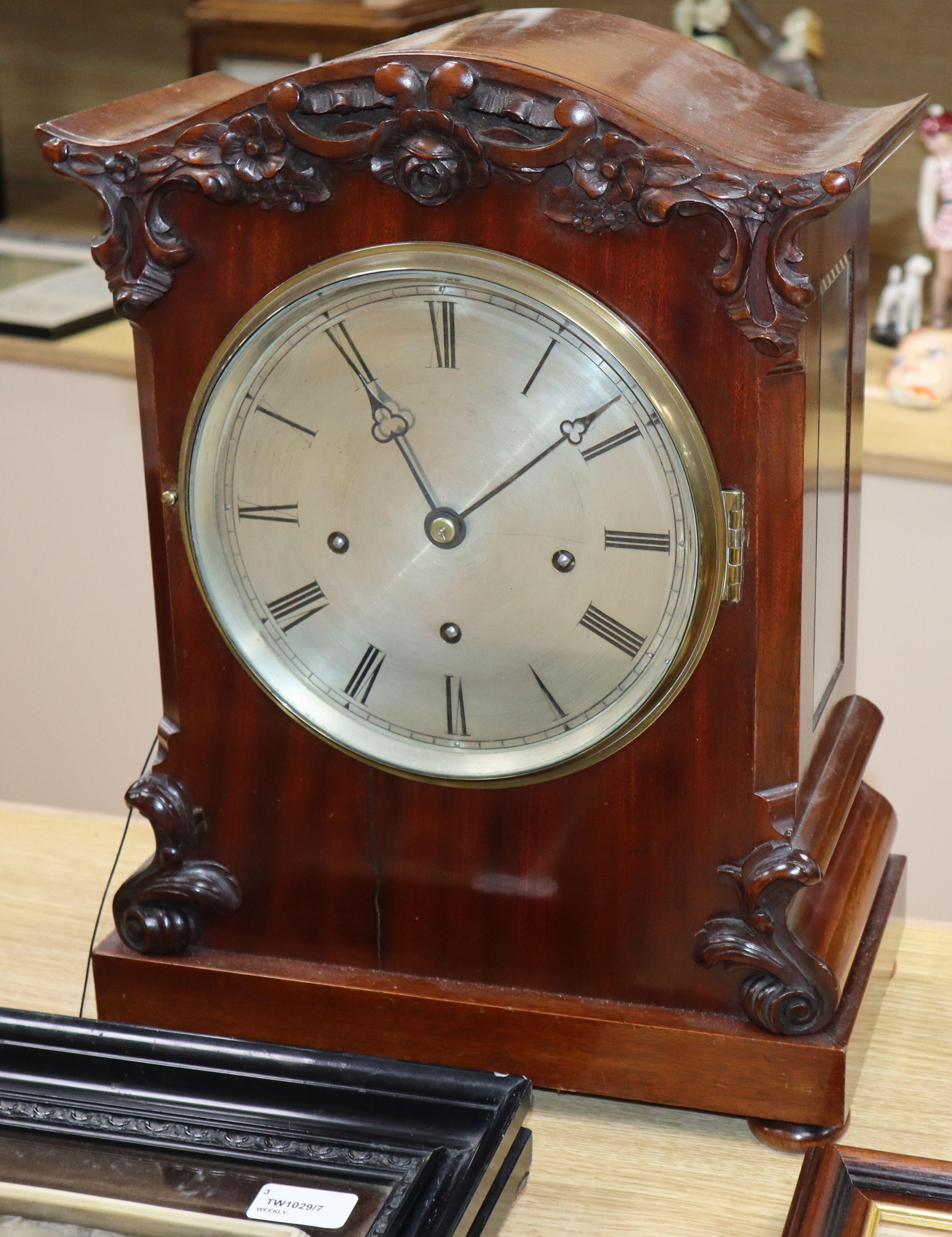 Lot 52 - A Victorian mahogany repeating bracket clock having silvered Roman dial, striking and chiming on