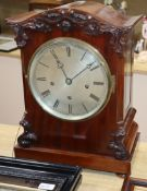 A Victorian mahogany repeating bracket clock having silvered Roman dial, striking and chiming on