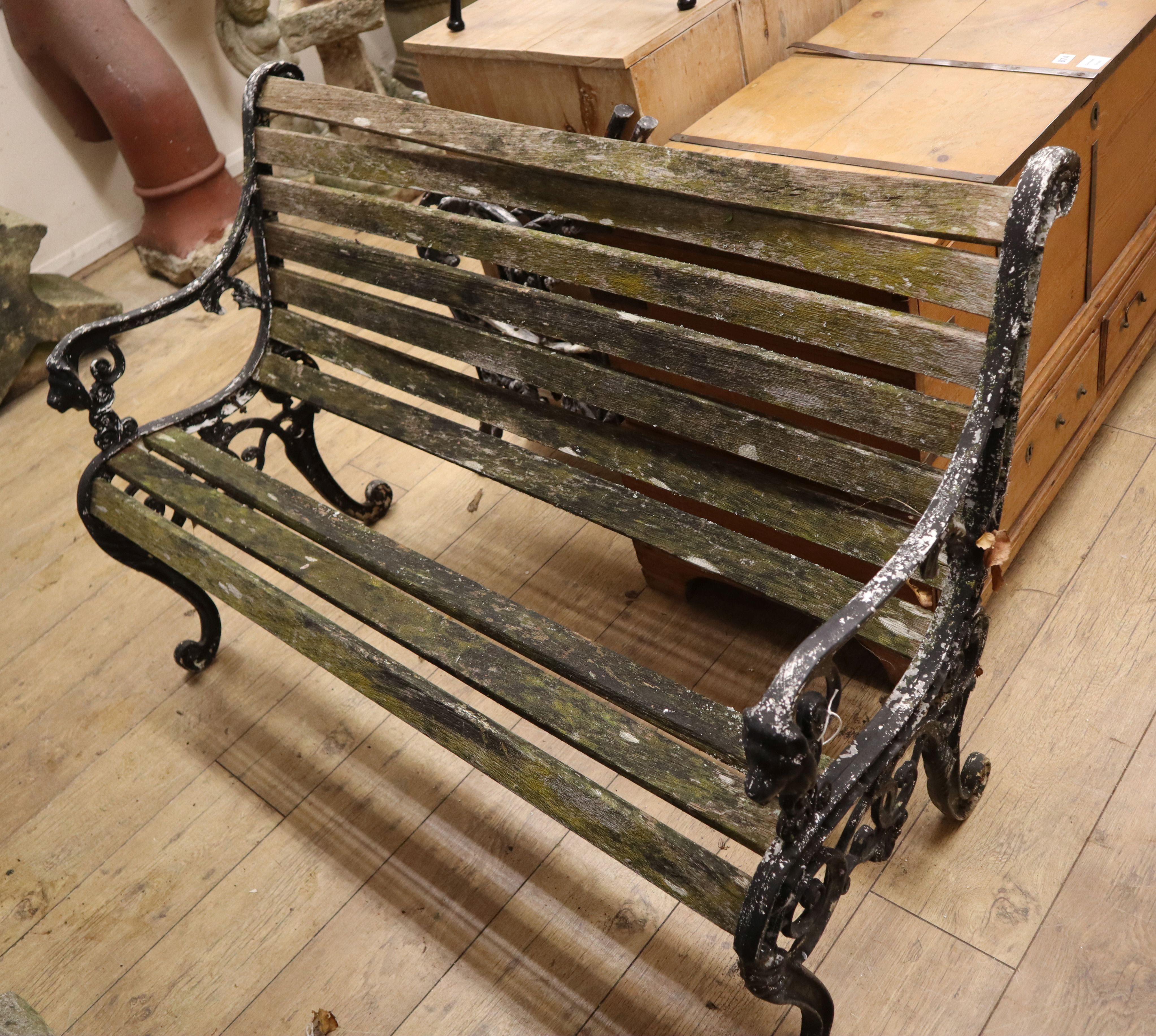 Lot 875 - A garden bench and two bench ends Bench W.125cm