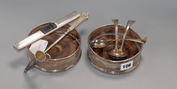 A pair of 19th century plated wine coasters and five other items, including candle extinguisher.
