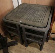 A weathered teak garden table and four chairs Table W.84cm