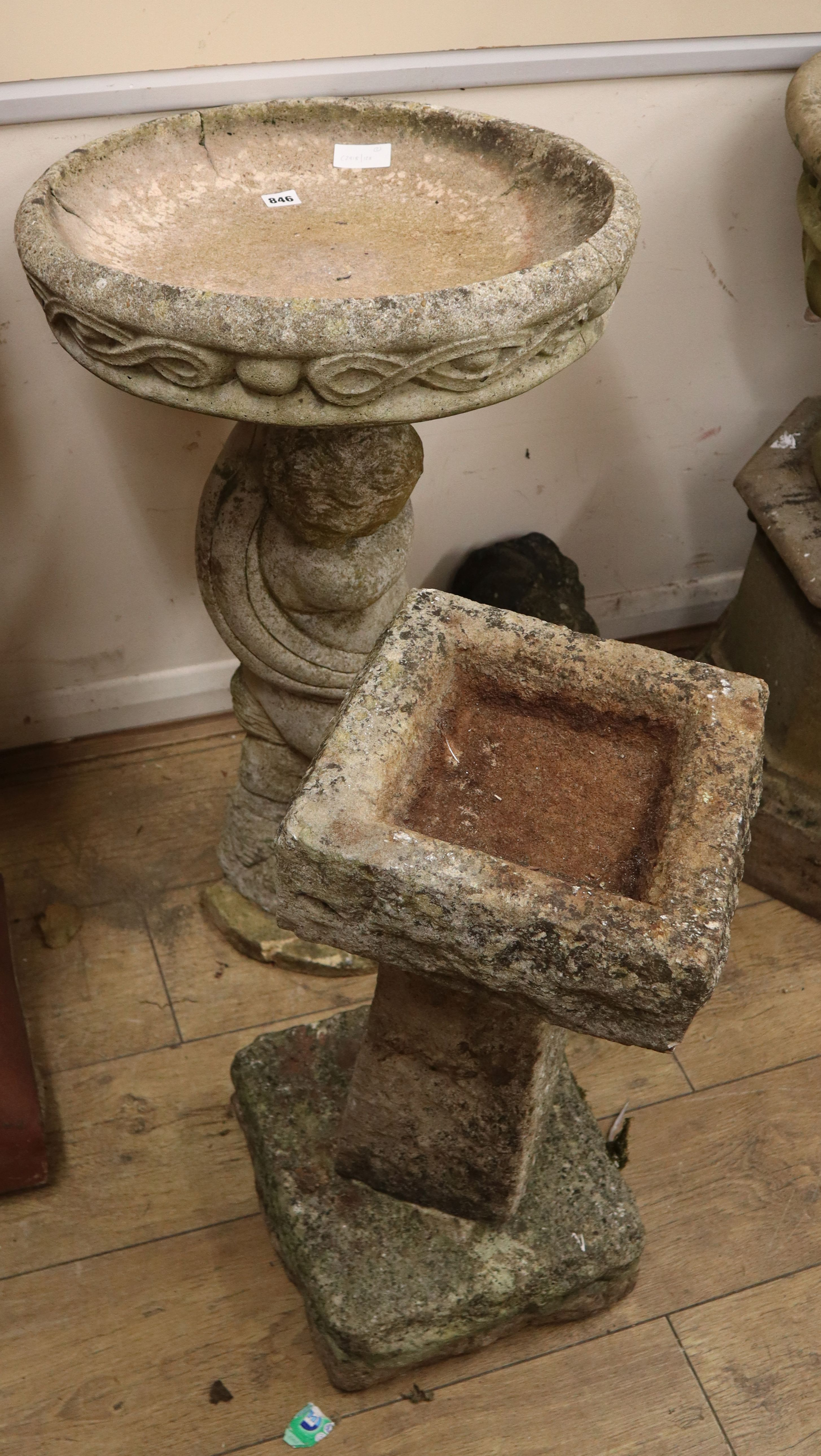 Lot 846 - Two reconstituted stone garden bird baths Larger H.80cm