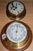 A ship's aneroid barometer and a bulkhead clock