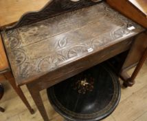 A late 19th century carved oak side table W.90cm