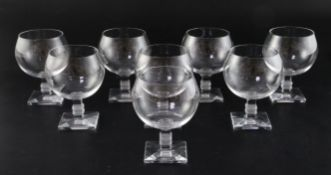 A set of eight Lalique 'Argos' pattern wine glasses, each on square stepped stem with moulded
