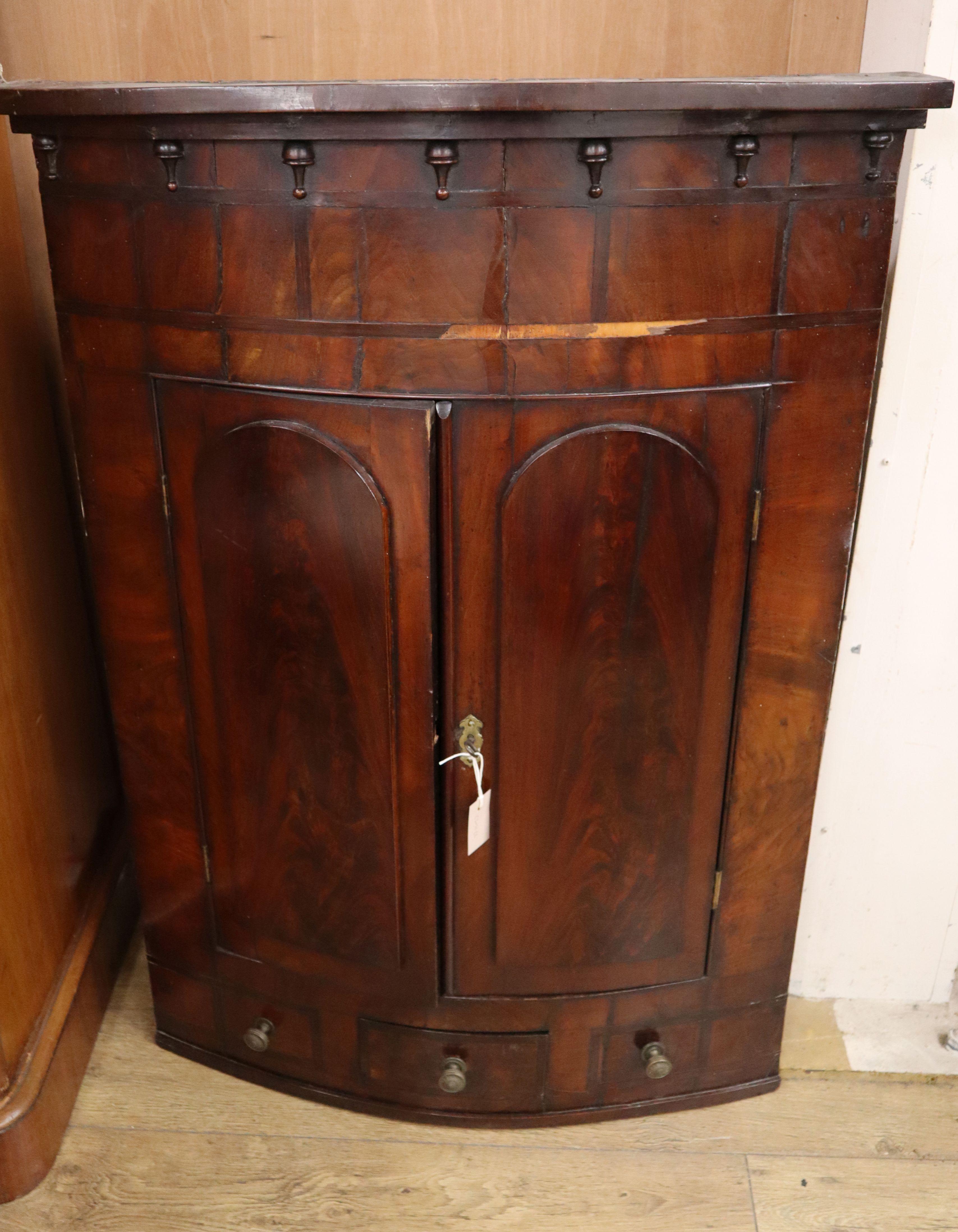 Lot 834 - A George III mahogany hanging corner cabinet W.86cm