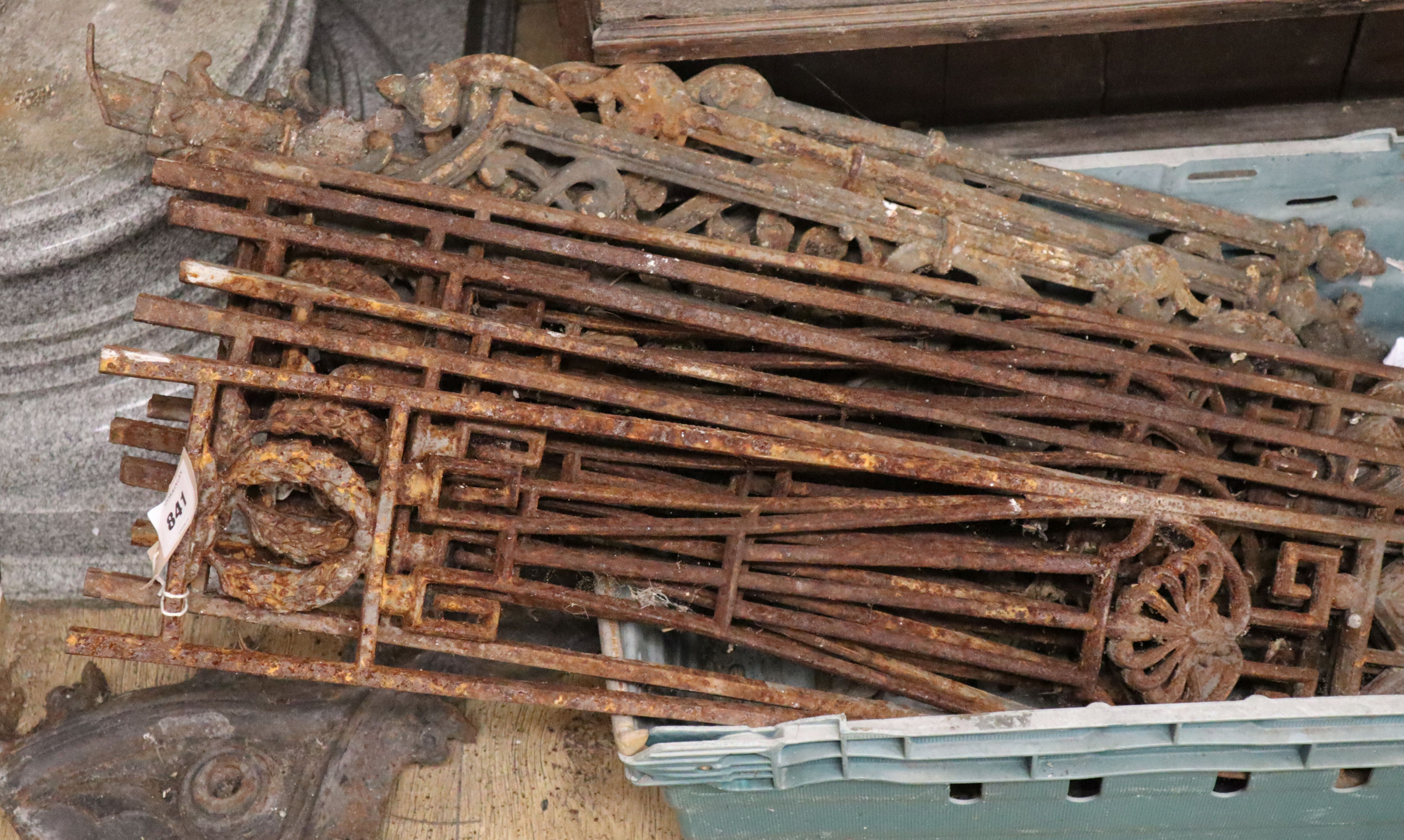 Lot 841 - Nine cast iron railings, gothic iron piece and an iron cover