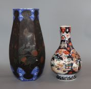 A 19th century Japanese Imari bottle vase and a Japanese lacquer and cloisonne porcelain vase