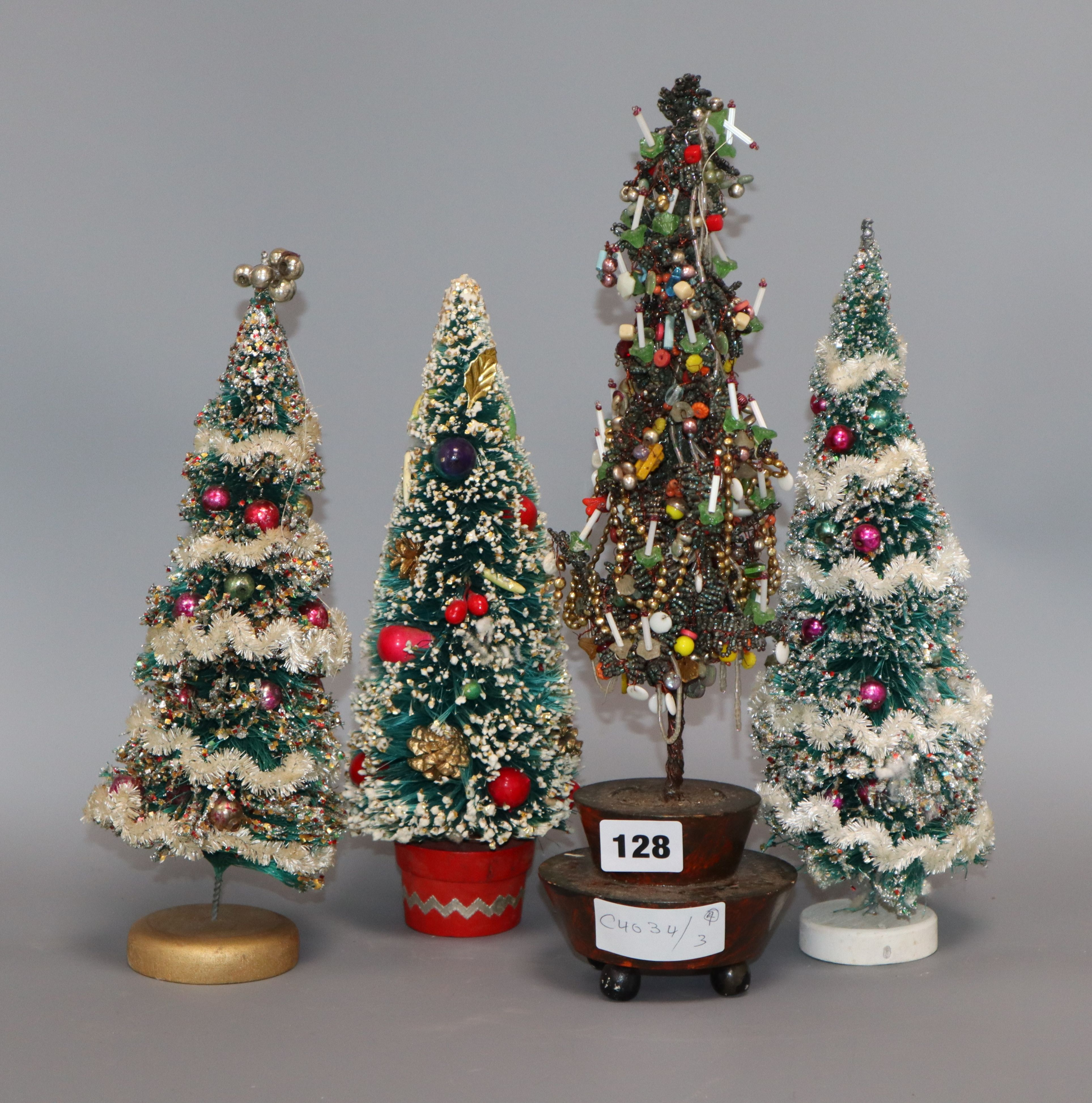 Lot 128 - A miniature beaded table christmas tree decorations and three others tallest 36cm