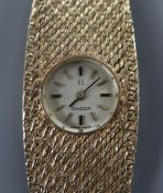 A lady's 1960's 9ct Omega manual back wind bracelet watch, approx. 17cm.