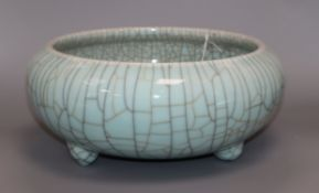 A large 19th century Chinese celadon crackle glaze tripod censer, repair to foot, height 14cm