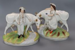 A pair of Staffordshire groups of a boy and girl with cows height 25cm