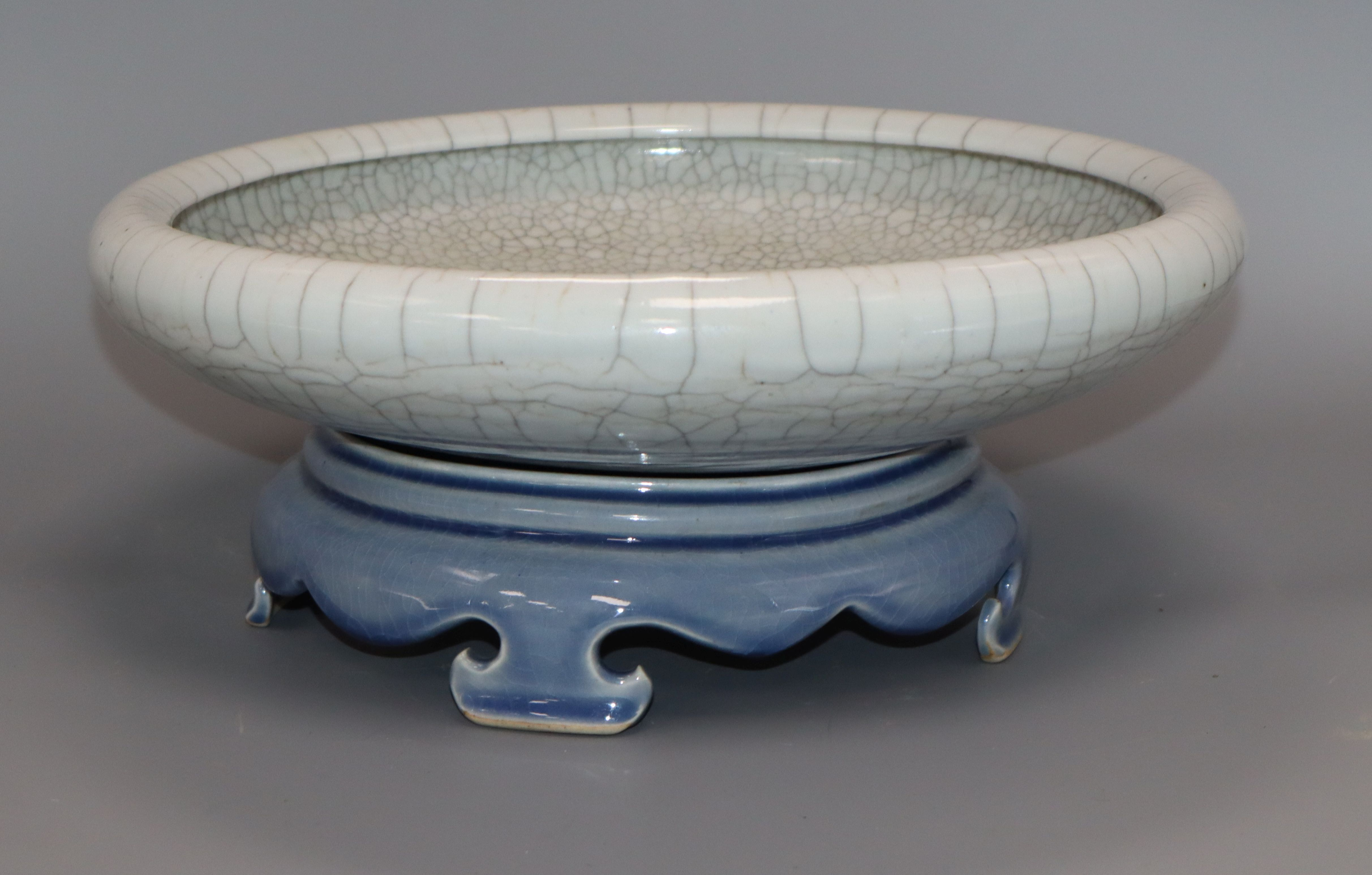 Lot 54 - A Chinese crackle glaze dish, late 19th century, later stand diameter 29cm