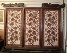 A large 19th century Javanese teak screen with Batik panels by Pamang 59cm