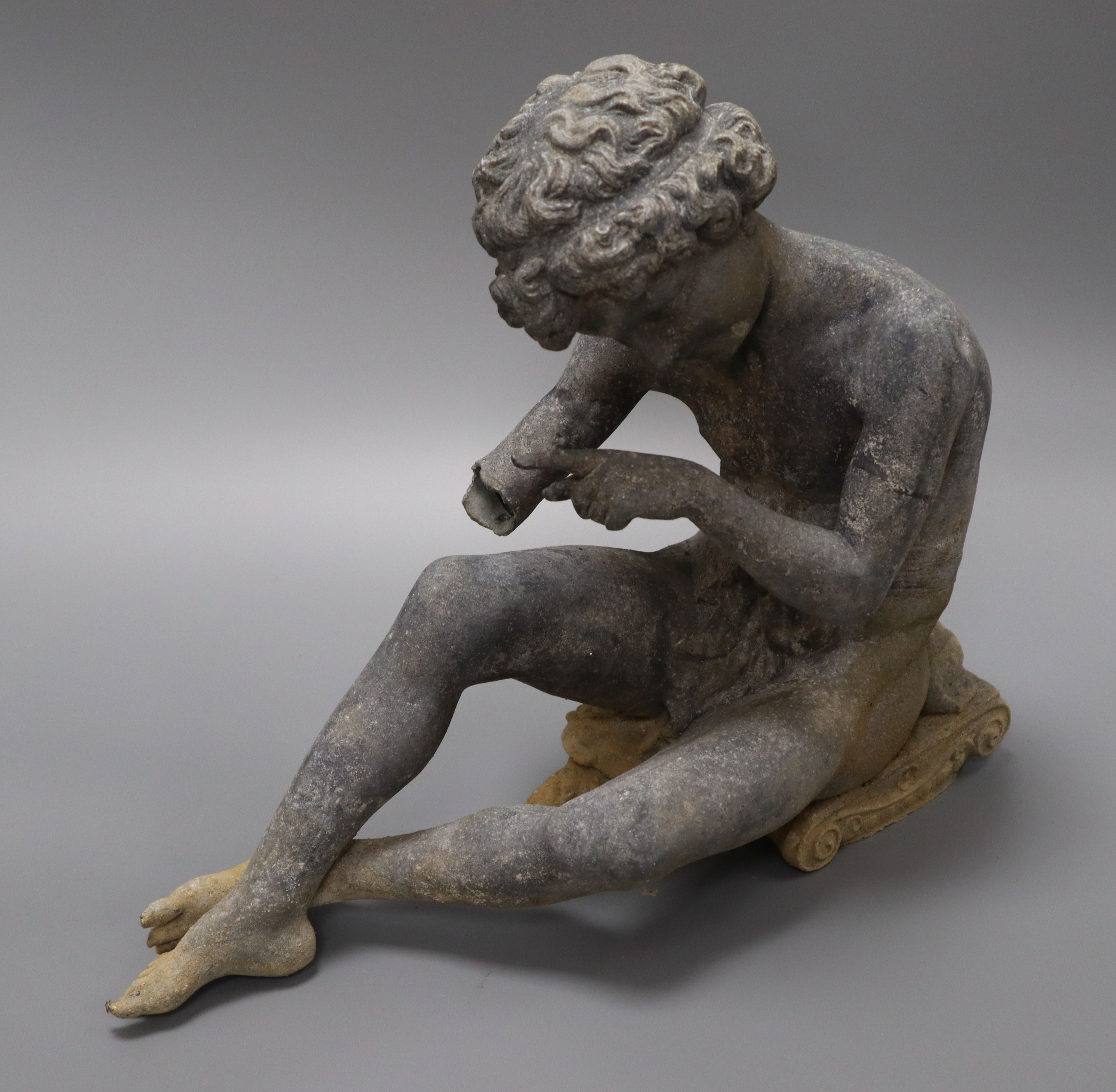 Lot 61 - A garden figure of a seated boy height 27cm