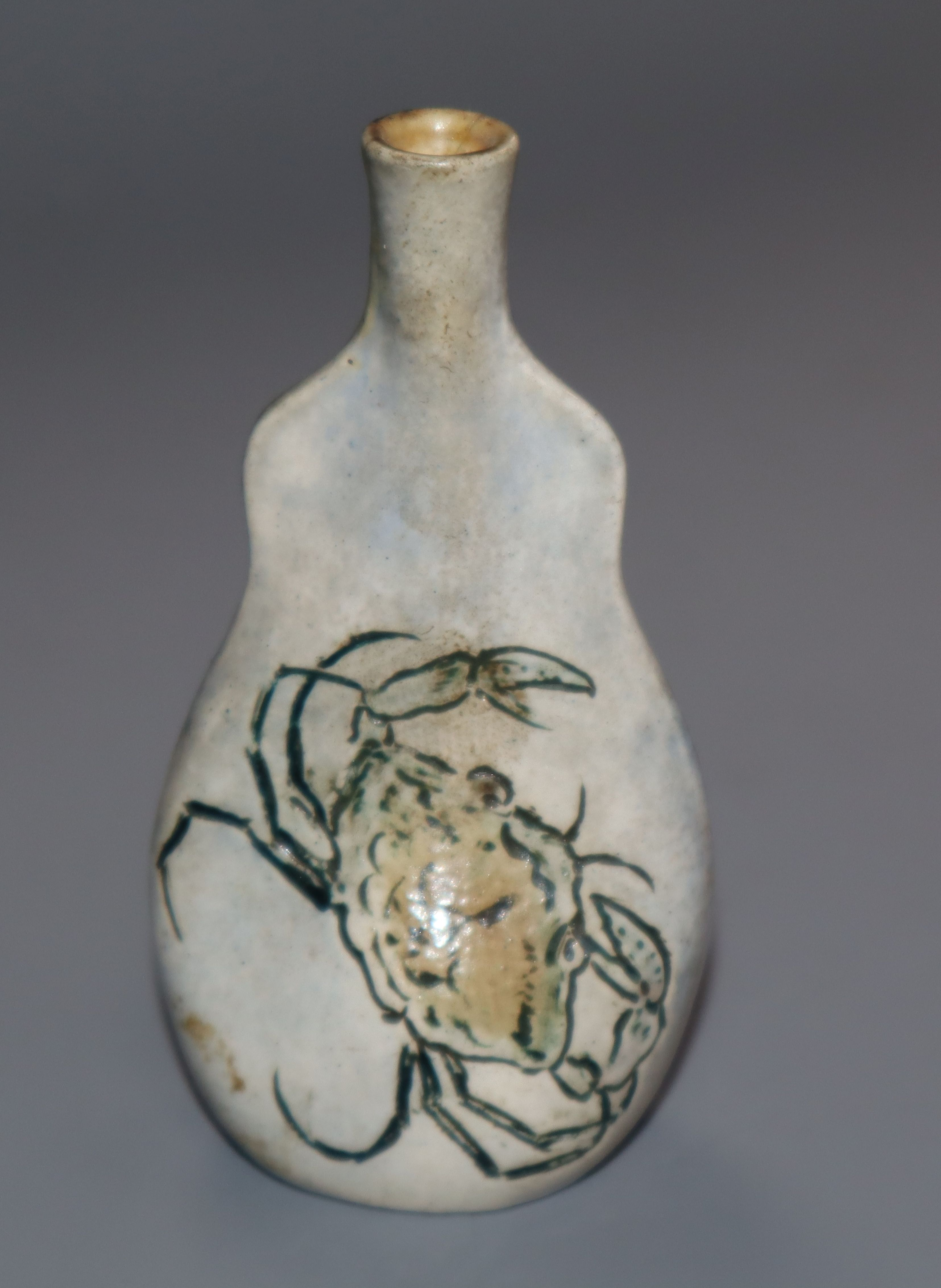 Lot 274 - A Martin Brothers miniature vase of pinched flask form, incised with crabs, signed to base (
