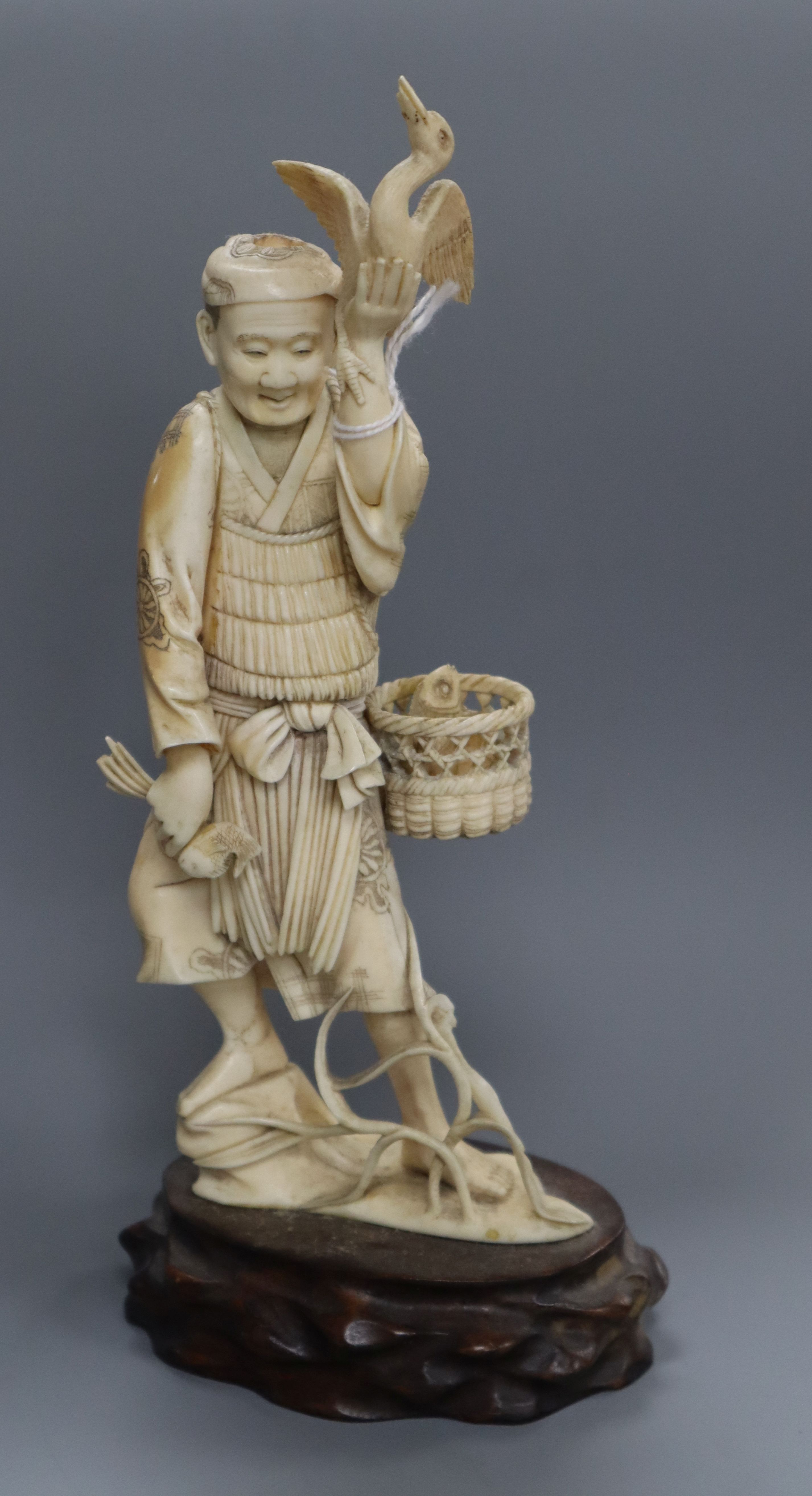 Lot 265 - A Japanese ivory figure of a cormorant fisherman, early 20th century height 24cm