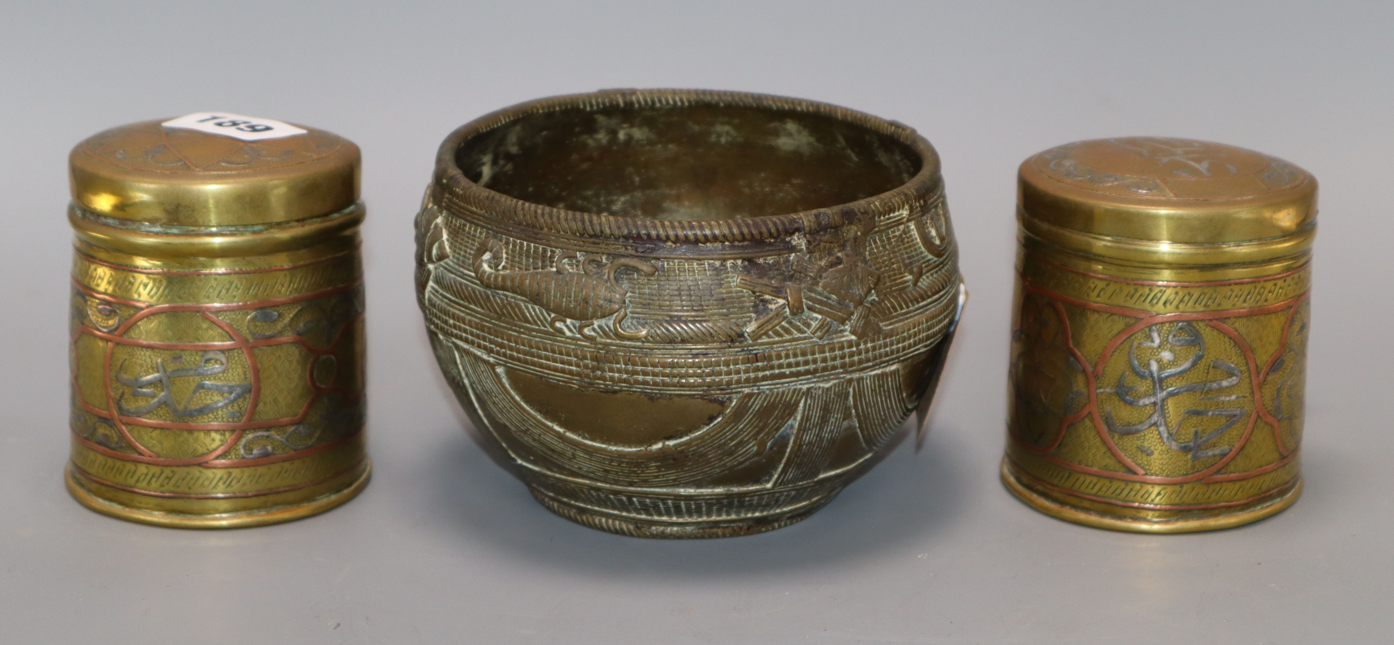 Lot 189 - Two Cairo ware canisters and a Benin style bowl