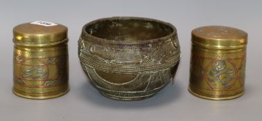 Two Cairo ware canisters and a Benin style bowl