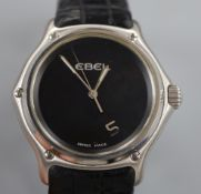 A gentleman's stainless steel Ebel 1911 quartz black dial wrist watch, no. E 9187241, on Ebel