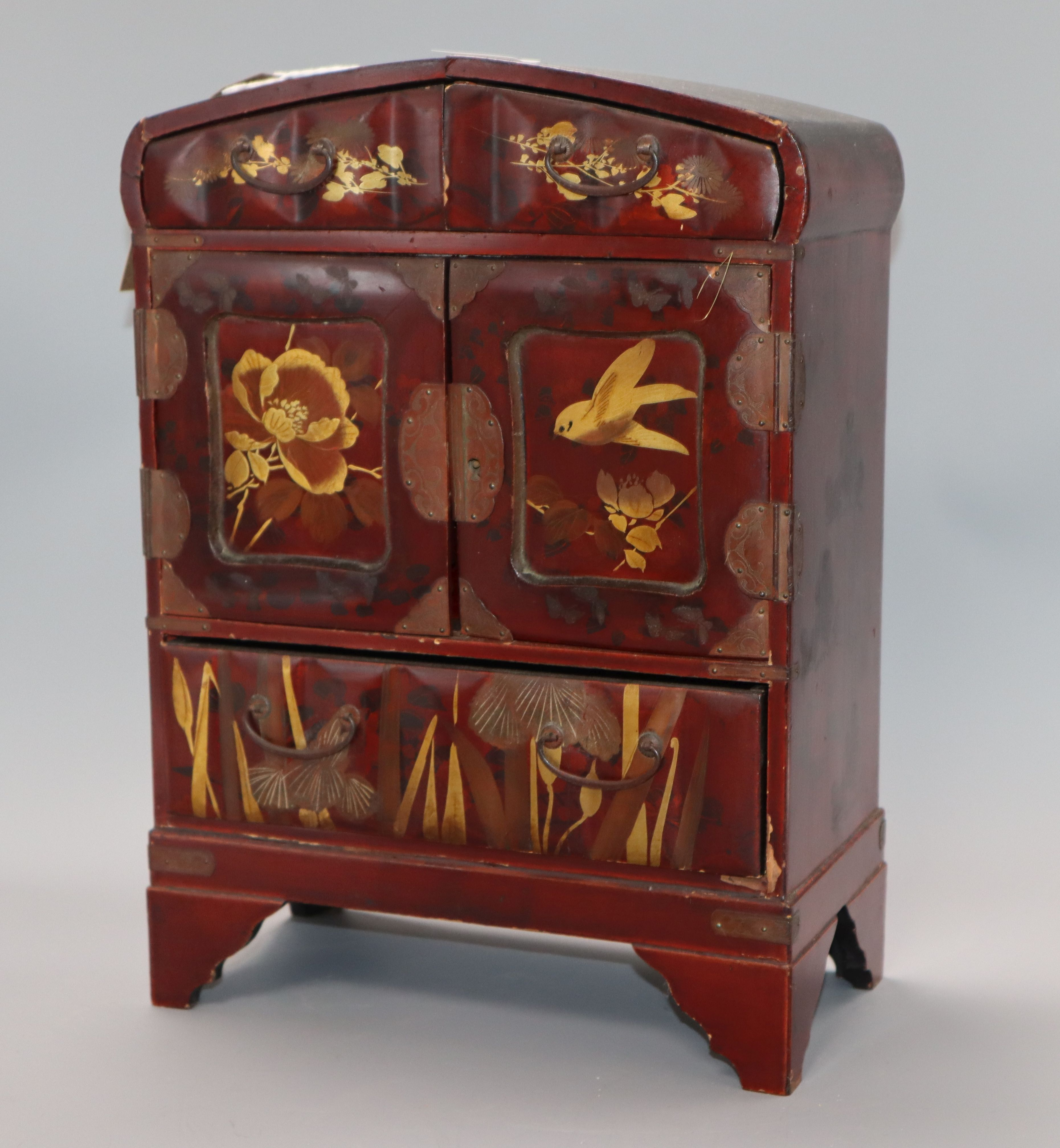 Lot 173 - A Japanese lacquered cabinet, with key height 34cm