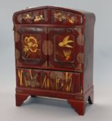 A Japanese lacquered cabinet, with key height 34cm