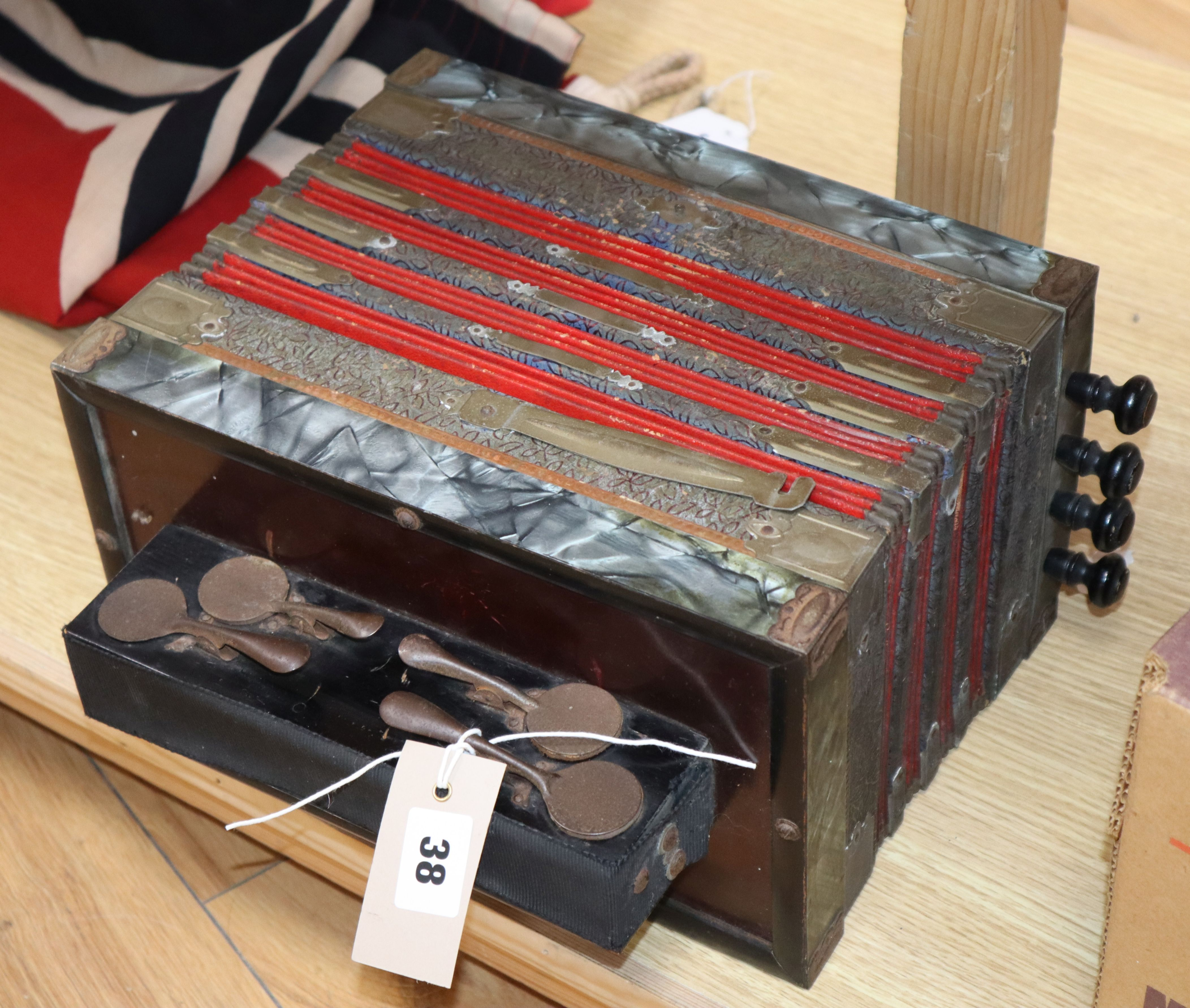 Lot 38 - A squeeze box